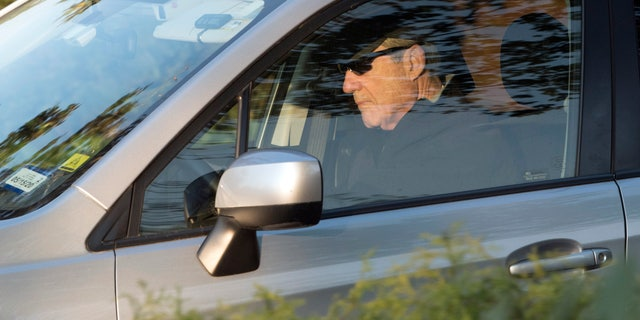 Special Counsel Robert Mueller drives away from his Washington home on Wednesday. Outstanding questions about the special counsel's Russia investigation have not stopped President Donald Trump and his allies from declaring victory. (AP Photo/Kevin Wolf)