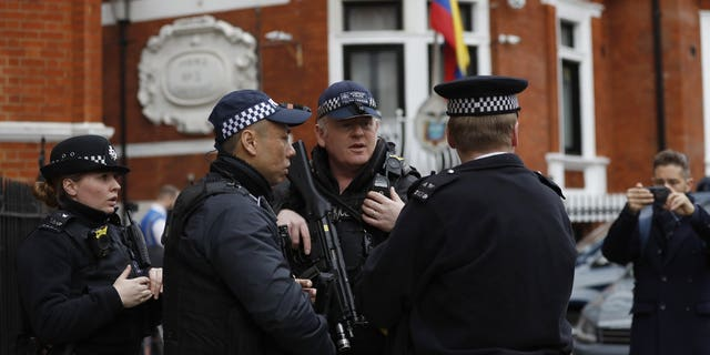 Armed police arrive outside the Ecuadorian Embassy, in London, Friday, April 5, 2019. WikiLeaks founder Julian Assange has been holed up there since 2012. (Associated Press)