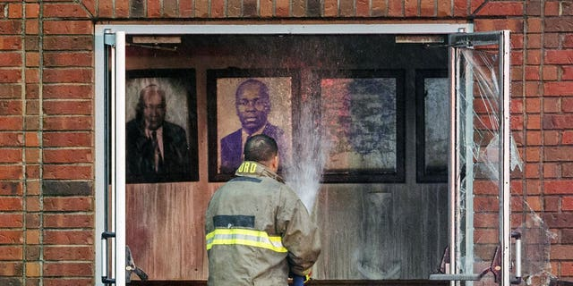 """Firefighters and fire investigators respond to a fire at Mt. Pleasant Baptist Church Thursday, April 4, 2019, in Opelousas, La. Authorities in southern Louisiana are investigating a string of """"suspicious"""" fires at three African American churches in recent days. Fire Marshal H. """"Butch"""" Browning said it wasn't clear whether the fires in St. Landry Parish are connected and he declined to get into specifics of what the investigation had yielded so far but described the blazes as """"suspicious."""""""