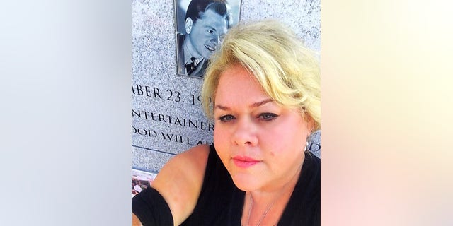 Kelly Rooney at her father's gravesite.