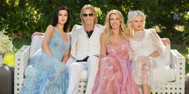 Susan Holmes McKagan with her husband Duff McKagan and their daughters.