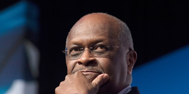 "In this June 20, 2014 file photo, Herman Cain, CEO, The New Voice, speaks during Faith and Freedom Coalition's Road to Majority event in Washington. President Donald Trump said Wednesday, April 10, 2019, that Cain is a ""wonderful man,"" but it will be up to him to decide whether to go forward with a nomination to the Federal Reserve's seven-member board. (AP Photo/Molly Riley, File)"