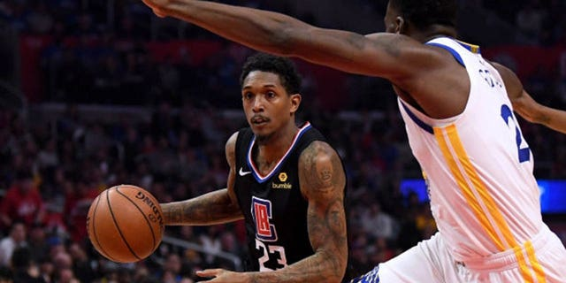 Lou Williams of the Los Angeles Clippers drives to the basket against Draymond Green of the Golden State Warriors during the 2019 NBA Playoffs at Staples Center in Los Angeles, April 21, 2019. (Getty Images)