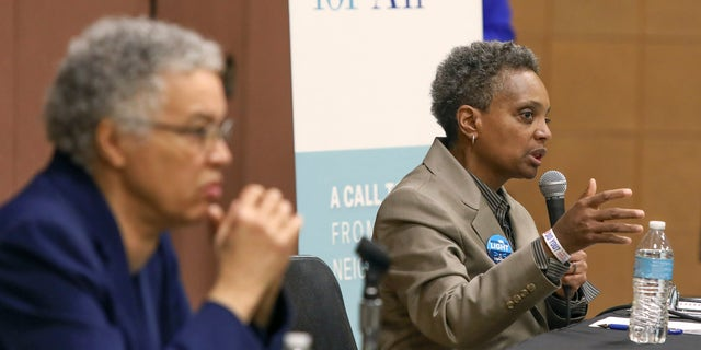 In this March 24, 2019 photo, Chicago mayoral candidate Lori Lightfoot, right, participates in a candidate forum in Chicago. Lightfoot and Toni Preckwinkle, left, are competing to make history by becoming the city's first black, female mayor. On issues their positions are similar. But their resumes are not, and that may make all the difference when voters pick a new mayor on Tuesday, April 2, 2019. (AP Photo/Teresa Crawford)