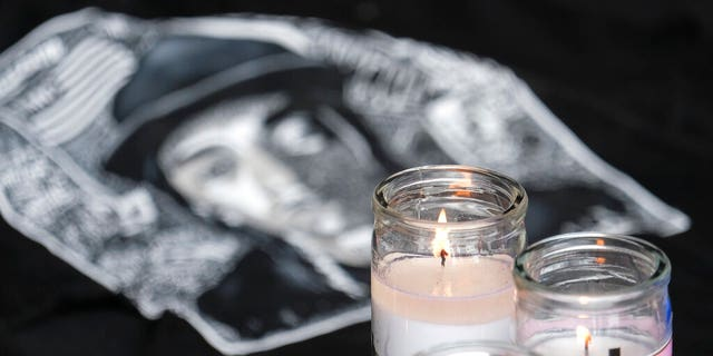 Candles appear at a memorial for Nipsey Hussle in the parking lot of his Marathon Clothing store in Los Angeles. (Associated Press)