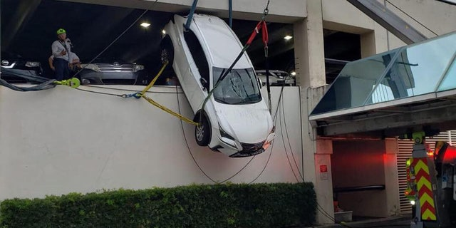 A woman in Florida was rescued from an SUV that was dangling from the second story of a parking garage.