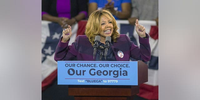 In this Nov. 2, 2018, file photo, Democrat Lucy McBath speaks during a rally for Democratic gubernatorial candidate Stacey Abrams, at Morehouse College in Atlanta.