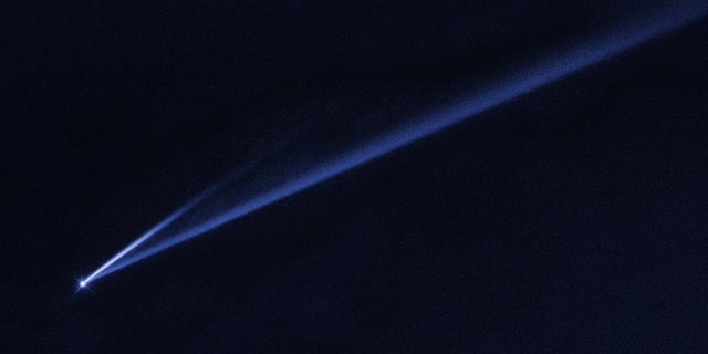 This Hubble Space Telescope image reveals the gradual self-destruction of the asteroid (6478) Gault, whose ejected dusty material has formed two long, thin, comet-like tails. The longer tail stretches more than 500,000 miles (800,000 kilometers) and is roughly 3,000 miles (4,800 km) wide. The shorter tail is about a quarter as long. The streamers will eventually disperse into space.