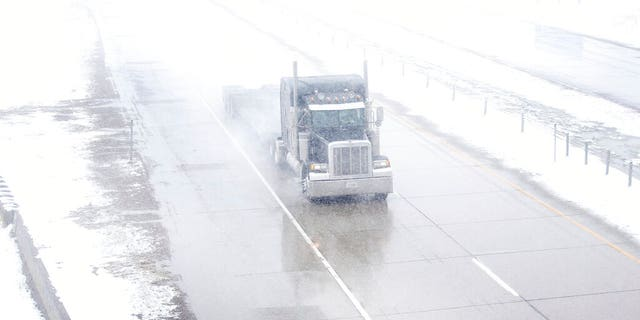 A truck travels east on Interstate 80 during a blizzard warning hitting southeast Wyoming and the Colorado Front Range on Wednesday, April 10, 2019, in Cheyenne.