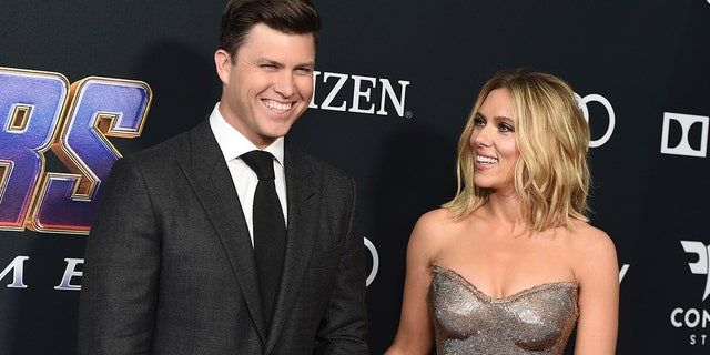"""Colin Jost, left, and Scarlett Johansson arrive at the premiere of """"Avengers: Endgame"""" at the Los Angeles Convention Center on Monday, April 22, 2019."""