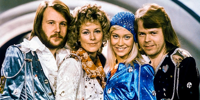 Swedish pop legends ABBA pose in their 1974 heyday. They've promised to release new music in fall 2019.