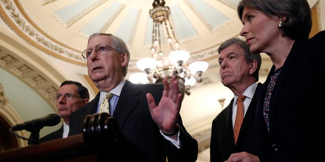 Senate Majority Leader Mitch McConnell of Ky., speaks to members of the media alongside Sen. John Barrasso, R-Wyo., from left, Sen. Roy Blunt, R-Mo., and Sen. Joni Ernst, R-Iowa, following a Senate policy luncheon, Tuesday, April 2, 2019, on Capitol Hill in Washington. (AP Photo/Patrick Semansky)