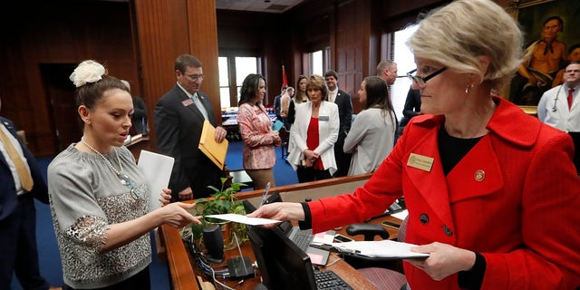 Actress Alyssa Milano, left, delivers a letter to Georgia Gov. Brian Kemp's office detailing her opposition to HB 481 at the State Capitol Tuesday, April 2, 2019, in Atlanta. HB 481 would ban almost all abortions after a fetal heartbeat can be detected.