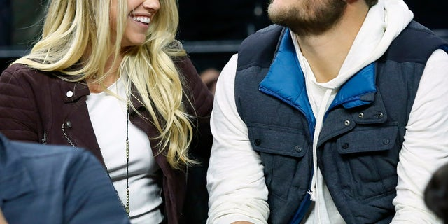 Detroit Lions quarterback Matthew Stafford with his wife, Kelly, in 2015.