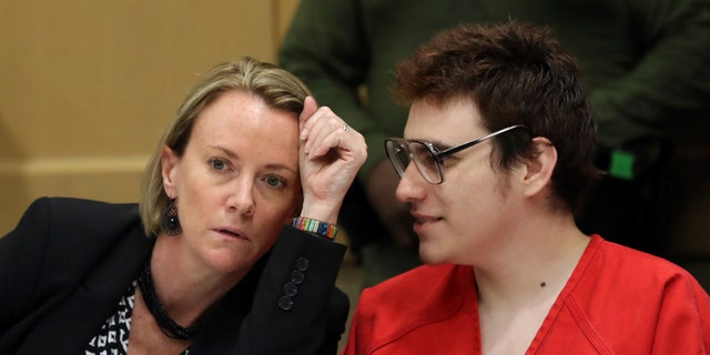 Defense attorney Melisa McNeill speaks with Parkland school suspect Nikolas Cruz during a hearing at the Broward Courthouse in Fort Lauderdale, Fla.