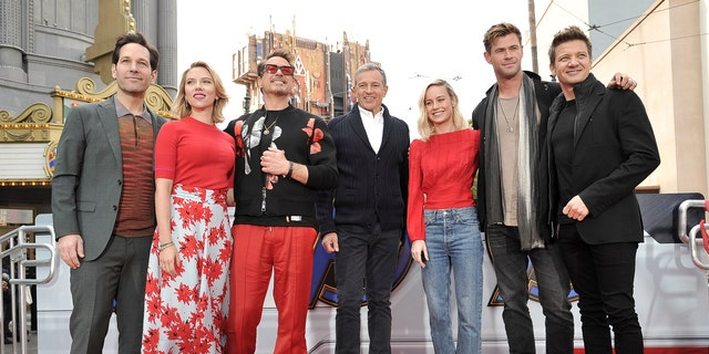 The actors behind the team of superheroes were photographed at the event with Iger.