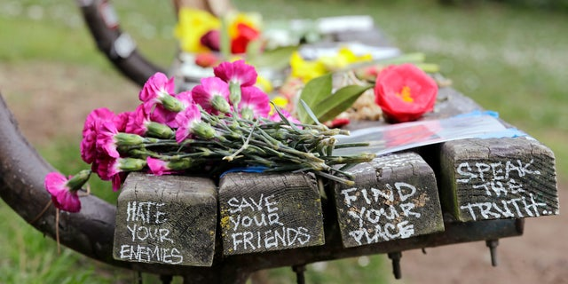 People gathered throughout the day at Viretta Parkin in Seattle on Friday, leaving flowers, candles and written messages on the 25th anniversary of Kurt Cobain's death.