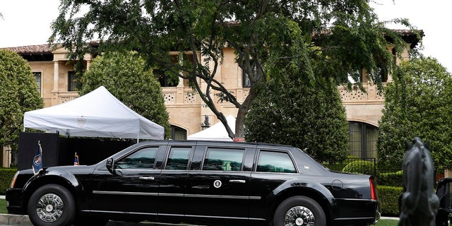 The presidential limo of President Donald Trump is parked on a hill in front of a private residence in Beverly Hills, Calif., as he meets with supporters during a fundraiser, Friday April 5, 2019. (Associated Press)