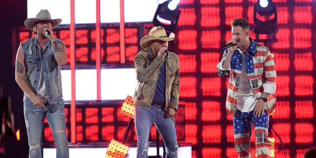 """Brian Kelley, left, and Tyler Hubbard, right, with Florida George Line, and Jason Aldean, center, appear"""" Can not hide the Red """"on the 54th, and the annual MGM Grand Garden Arena Academy Award on Sunday, April 7, 2019, in Las Vegas."""