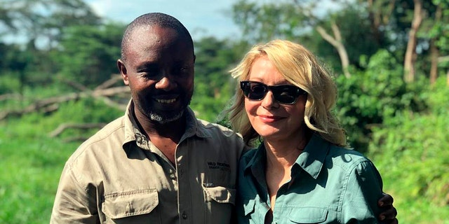 Kimberly Endicott with her guide, JP Mirenge Remezo, a day after they were rescued following a kidnapping by unknown gunmen in Uganda's Queen Elizabeth National Park.