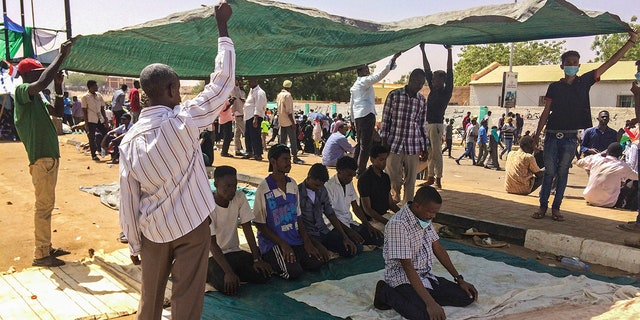 Protesters pray during a demonstration near the military headquarters, Tuesday, April 9, 2019, in the capital Khartoum, Sudan. Activists behind anti-government protests in Sudan say security forces have killed at least seven people, including a military officer, in another attempt to break up the sit-in outside the military headquarters in Khartoum. A spokeswoman for the Sudanese Professionals Association, said clashes erupted again early Tuesday between security forces and protesters who have been camping out in front of the complex in Khartoum since Saturday. (AP Photo)