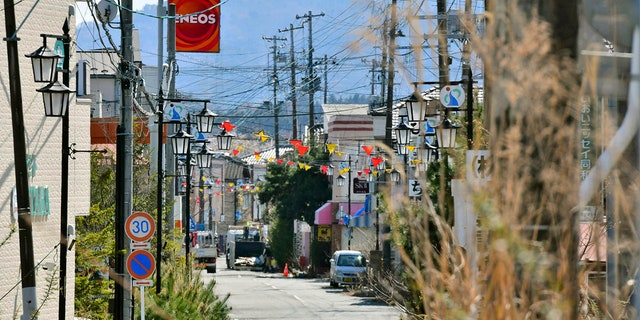 This April 9, 2019, photo shows central area of Okuma town, Fukushima. Japan has partially lifted an evacuation order in one of the two hometowns of the tsunami-wrecked Fukushima nuclear plant for the first time since the 2011 disaster. The action taken Wednesday, April 10, 2019, allows people to return about 40 percent of Okuma. The area seen in this photo is still under evacuation order. (Kyodo News via AP)