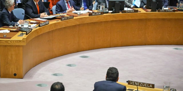 United States Vice President Mike Pence, second from left top, looks at Venezuela United Nations Ambassador Samuel Moncada, bottom right, while addressing him directly during a meeting on Venezuela in the U.N. Security Council, April 10, 2019 at U.N. headquarters. (AP Photo/Bebeto Matthews)