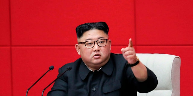 In this photo provided by the North Korean government, North Korean leader Kim Jong Un attends the 4th Plenary Meeting of the 7th Central Committee of the Workers' Party of Korea in Pyongyang. (Korean Central News Agency/Korea News Service via AP)