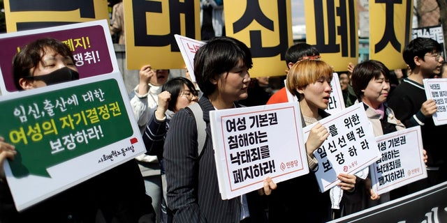 Protesters shout slogans during a rally demanding the abolition of the country's ban on abortions outside of the Constitutional Court in Seoul, South Korea. (AP Photo/Lee Jin-man)