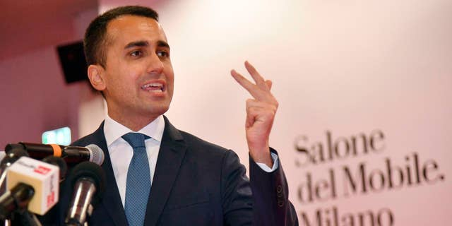 Italian Deputy Premier and Labour and Industry Minister, Luigi Di Maio, gestures while attending a press conference during his visit to the Salone del Mobile Furniture Fair, near Milan, Italy, Friday, April 11, 2019.