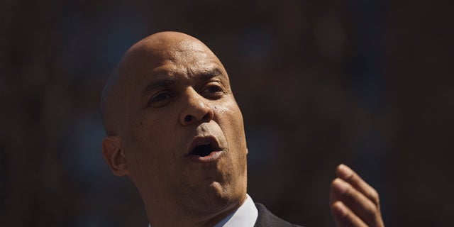 Democratic presidential candidate Sen. Cory Booker, D-N.J., talks to the crowd during a hometown kickoff for his national presidential campaign tour at Military Park in downtown Newark on Saturday. (AP Photo/Andres Kudacki)