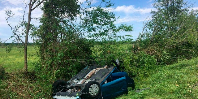 A car drops upside down in a ditch as a result of an alleged tornado on Saturday, April 13, 2019 in Franklin, Texas. (Associated Press)