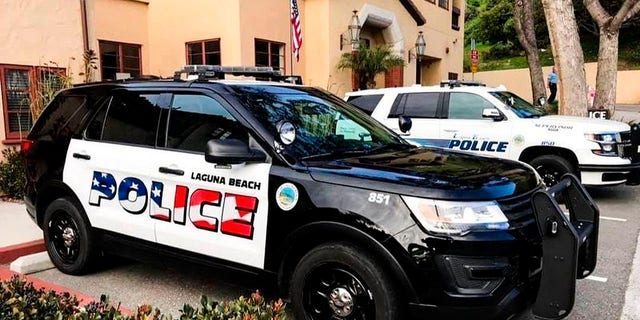 This undated photo provided by the Laguna Beach Police Department shows their newly decorated Police SUV patrol vehicles in Laguna Beach, Calif. Seven out of the department's 11 cars have already been painted, the department said in a text to the Los Angeles Times.