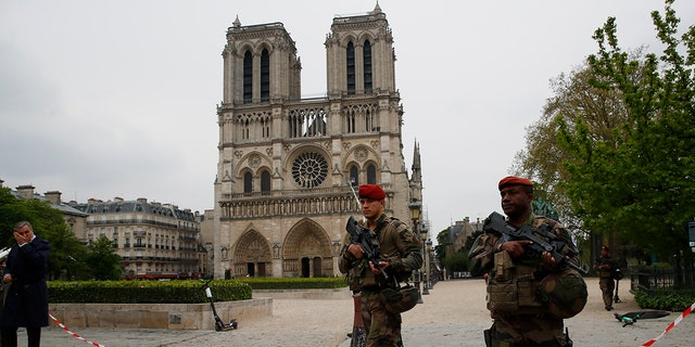 Firefighters declared success Tuesday in a more than 12-hour battle to extinguish an inferno engulfing Paris' iconic Notre Dame cathedral that claimed its spire and roof, but spared its bell towers. (AP Photo/Francois Mori)