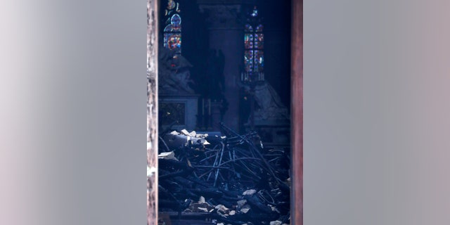 This picture shows charred debris inside Notre Dame cathedral Tuesday April 16, 2019. Firefighters declared success Tuesday morning in an over 12-hour battle to extinguish an inferno engulfing Paris' iconic Notre Dame cathedral that claimed its spire and roof, but spared its bell towers.