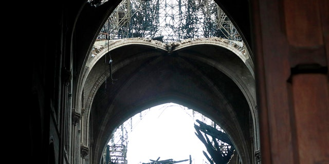 A hole is seen in the dome inside Notre cathedral in Paris, Tuesday, April 16, 2019. Firefighters declared success Tuesday in a more than 12-hour battle to extinguish an inferno engulfing Paris' iconic Notre Dame cathedral that claimed its spire and roof, but spared its bell towers and the purported Crown of Christ.