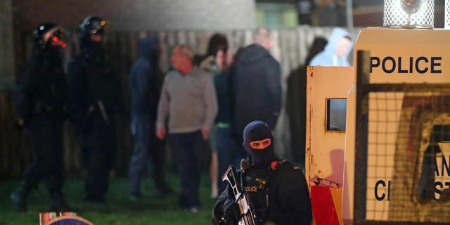 Armed police stage at the scene of unrest in Creggan, Londonderry, in Northern Ireland, Thursday, April 18, 2019.