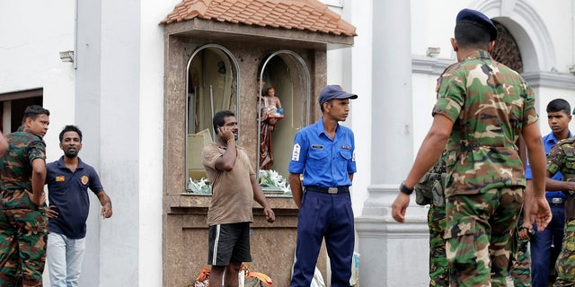 People gather outside St. Anthony's Shrine where a blast happened, in Colombo, Sri Lanka, Sunday, April 21, 2019. (Associated Press)