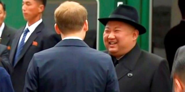 North Korean leader Kim Jong Un smiles as he leaves a train in Vladivostok railway station in Vladivostok, Russia.
