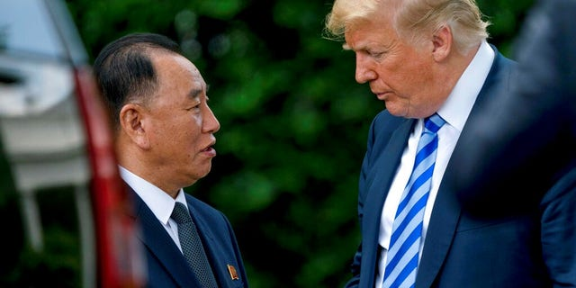 President Donald Trump shakes hands with Kim Yong Chol, former North Korean military intelligence chief and one of leader Kim Jong Un's closest aides.