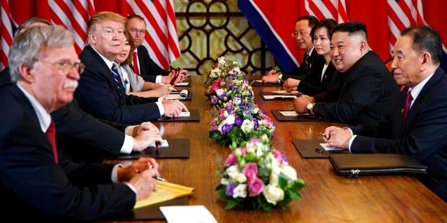 President Donald Trump speaks during a meeting with North Korean leader Kim Jong Un Thursday, Feb. 28, 2019, in Hanoi. At front right is Kim Yong Chol, a North Korean senior ruling party official and former intelligence chief.