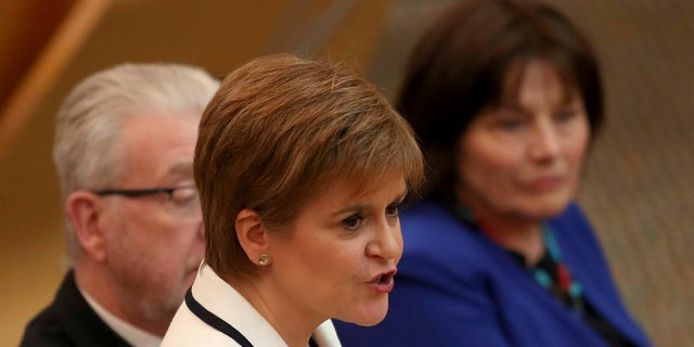 First Minister of Scotland Nicola Sturgeon issues a statement on Brexit and independence in the main chamber at the Scottish Parliament, Edinburgh, Wednesday April 24, 2019.  (Jane Barlow/PA via AP)