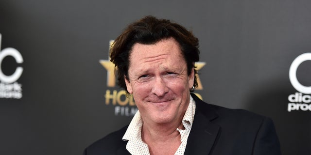 FILE - In this Nov. 1, 2015 file photo, Michael Madsen arrives at the Hollywood Film Awards at the Beverly Hilton Hotel in Beverly Hills, Calif. Prosecutors have charged Madsen with two misdemeanor counts of drunken driving after the actor drove his SUV into a pole last month.