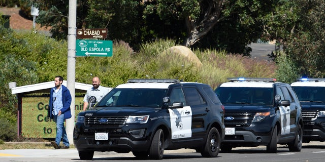 San Diego County Sheriff's vehicles seen lined up outside of the Chabad of Poway Synagogue on Saturday in Poway, Calif. Several people were injured in a shooting at the synagogue. (AP Photo/Denis Poroy)