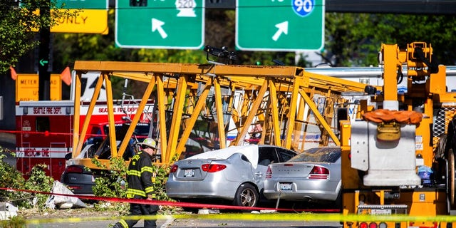 Emergency crews work the scene of a construction crane collapse near the intersection of Mercer Street and Fairview Avenue near Interstate 5 in Seattle.