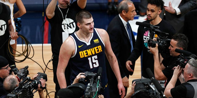 Denver Nuggets center Nikola Jokic faces the cameras after the second half of Game 7 of an NBA basketball first-round playoff series, Saturday, April 27, 2019, in Denver. The Nuggets won 90-86 to advance to the second round against Portland. (Associated Press)