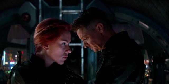 "This image released by Disney shows Scarlett Johansson, left, and Jeremy Renner in a scene from ""Avengers: Endgame."" (Disney/Marvel Studios via AP)"