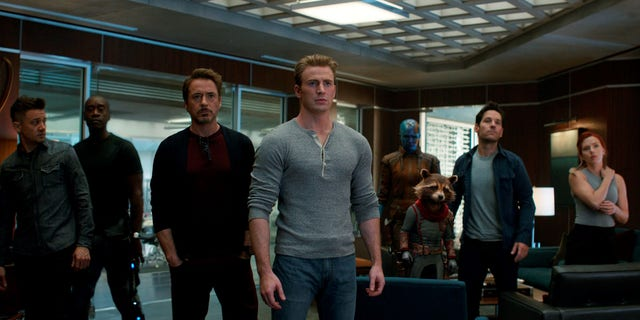 (L-R) Jeremy Renner, Don Cheadle, Robert Downey Jr., Chris Evans, Karen Gillan, the character Rocket, voiced by Bradley Cooper, Paul Rudd and Scarlett Johansson in a scene from 'Avengers: Endgame.'