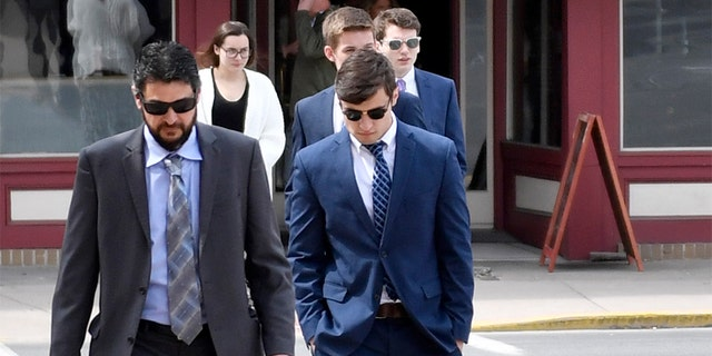 An attorney and several Beta Theta Pi brothers head to the courthouse for sentencing on Tuesday.