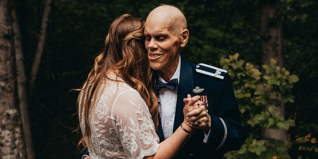 The Virginia woman looked lovely in her wedding gown, her veteran father handsome in his U.S. Air Force dress blues.
